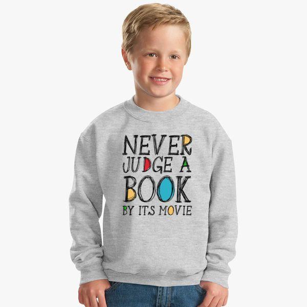 47757b1e Never Judge a Book by it's movie Kids Sweatshirt - Customon